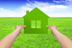 Make your house concept, hands hold house Stock Photo