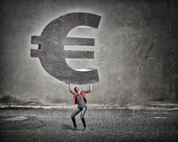 Make your income grow. Young girl in red jacket lifting euro sign above head Stock Photography