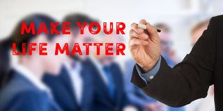 Make your life matter, business man hand writing with team. Make your life matter, Male hand in business wear holding a thick pen, writing on an imaginary screen Stock Images