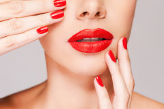 Make your lips match your fingers. Stock Photos
