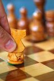 Make Your Move. Chess move with white knight: handcarved pieces Stock Photo