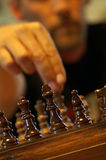 Make Your Move. A man making his next move in a game of chess. (soft focus on the player royalty free stock images