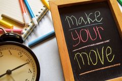 Make your move on phrase colorful handwritten on chalkboard, alarm clock with motivation and education concepts. stock photos