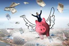 Make your savings work for you . Mixed media . Mixed media. Young cheerful businesswoman flying on pink piggy bank. Mixed media Royalty Free Stock Photography