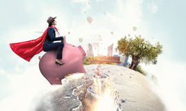 Make your savings work for you . Mixed media. Young cheerful businesswoman flying on pink piggy bank. Mixed media Royalty Free Stock Images
