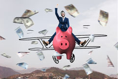 Make your savings work for you . Mixed media. Young cheerful businesswoman flying on pink piggy bank. Mixed media Royalty Free Stock Image
