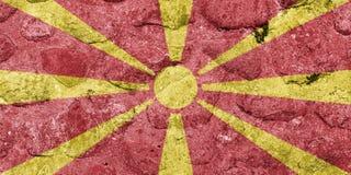 Makedonien flagga på en stenvägg stock illustrationer