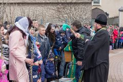 Makeevka, Ukraine - April 01, 2018: Priest performs the ritual with the parishioners to consecrating the willow. In the Christian Holiday Palm Sunday Royalty Free Stock Images