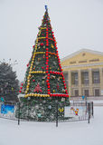 Makeevka, Ukraine - December, 24, 2014: Christmas tree in the to. Wn square during a truce and blockades in arranging the Kiev government Stock Image
