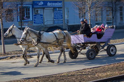 Makeevka, Ukraine - February, 22, 2015: Children ride on a cart Stock Photo