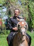 Makeevka, Ukraine - May, 7, 2014: Cossack in uniform on horsebac Royalty Free Stock Image