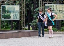 Makeevka, Ukraine - May 29, 2015: Graduates near the fountain. T Royalty Free Stock Photos