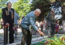 Makeevka, Ukraine - May, 7, 2014: World War II veterans laid flo Stock Photo