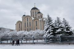 Makeevka, Ukraine - November 2, 2017: Church of the Cathedral of St. George. And parishioners in winter Royalty Free Stock Photography