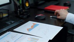 Makelaar Analyzing Business Chart stock footage