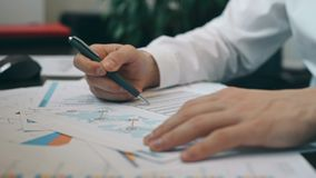 Makelaar Checking Business Plan stock footage