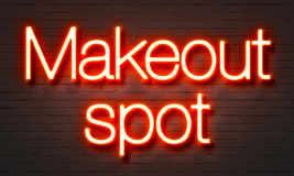 Makeout spot neon sign on brick wall background. Royalty Free Stock Images