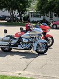 Twin motorcycles parked side by side royalty free stock image