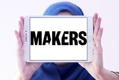 MAKERS video platform logo. Logo of MAKERS video platform on samsung tablet holded by arab muslim woman. MAKERS is a video platform for the trailblazing women of Stock Image