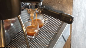 Makes two coffees stock footage