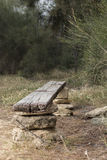 Makeshift bench. Made of wood and stones Stock Images