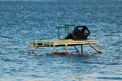 Makeshift fishing platform in water stock photography