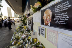 A makeshift place for visitors to pay last respect to beloved Mr. Lee Kuan Yew, founding father of modern Singapore. Local and foreigners laying flowers, cards Stock Images