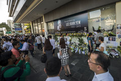 A makeshift place for visitors to pay last respect to beloved Mr. Lee Kuan Yew, founding father of modern Singapore. Local and foreigners laying flowers, cards Stock Photography