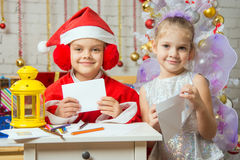 Makeshift Santa Claus And Fairy Prepare Congratulatory Letters Stock Photography