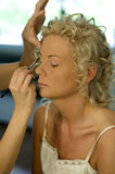 Makeup. Beautician creating wedding makeup for a young woman Royalty Free Stock Photography
