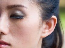 Makeup. A beautiful girl to put on makeup stock images