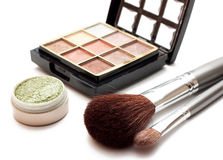Makeup. Set with brushes and eye shadows isolated on white Stock Images