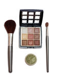 Makeup. Set with brushes and eye shadows isolated on white Stock Photos