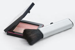 MakeUp. A Makeup brush placed beside a powder box Stock Photos