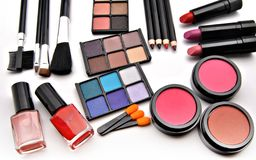 Makeup. Paints for the eyes of various colors placed next to each other with various  pencils and supplies makeup Royalty Free Stock Photography