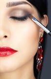Κινηματογράφηση σε πρώτο πλάνο που πυροβολείται του ματιού γυναικών makeup Στοκ Εικόνα
