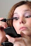 Makeup. Young beatiful woman doing makeup Stock Images