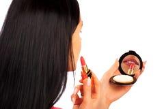 Makeup. Pretty woman applying makeup Stock Photography