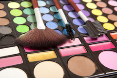 Makeup accessories. Makeup brushes and makeup eye shadows Stock Image