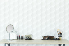 Makeup accessories on a desk Royalty Free Stock Photography