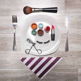 Makeup accessories on a dinner plate Stock Photo