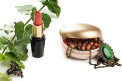 Makeup accessories with necklace Stock Photo