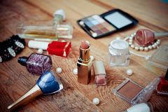 Makeup accessories on wooden Royalty Free Stock Photo