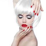 Makeup And Hairstyle. Red Lips And Manicured Nails. Fashion Beau Royalty Free Stock Image