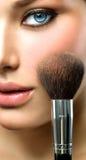 Makeup applying stock photography