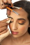 Makeup Aritsit and Beautiful Girl Royalty Free Stock Photography