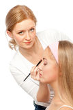 Makeup Artist. Beautician Applying Woman's Make Up.Isolated on white Royalty Free Stock Image