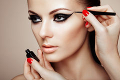 Makeup artist applies eye shadow Royalty Free Stock Photos