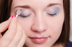Makeup artist applies eye shadow model Stock Photos