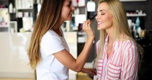 Makeup artist applies eye shadow. Perfect makeup stock photography